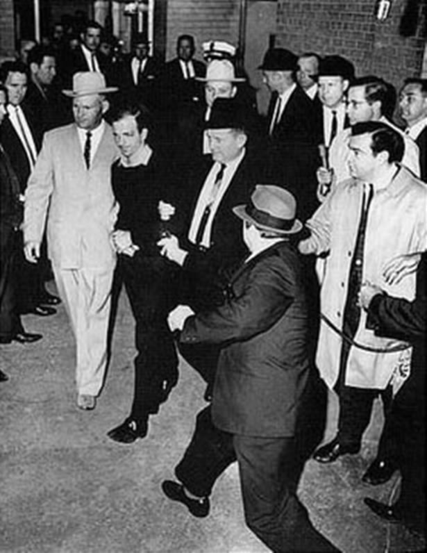 Lee Harvey Oswald being shot by Jack Ruby as Oswald is being moved by police 1963 image