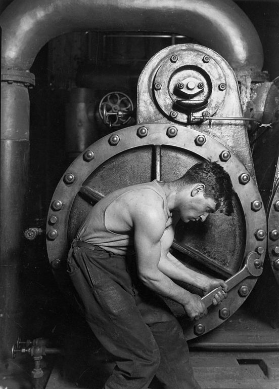 552px Lewis Hine Power house mechanic working on steam pump image