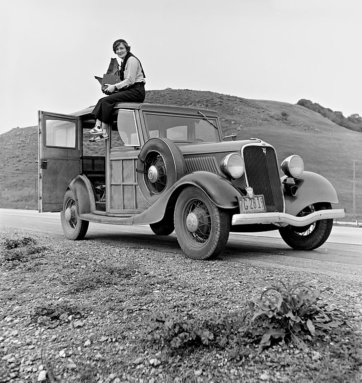 726px Dorothea Lange atop automobile in California image
