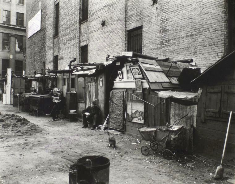 Huts and unemployed in West Houston and Mercer St by Berenice Abbott in Manhattan in 1935 image
