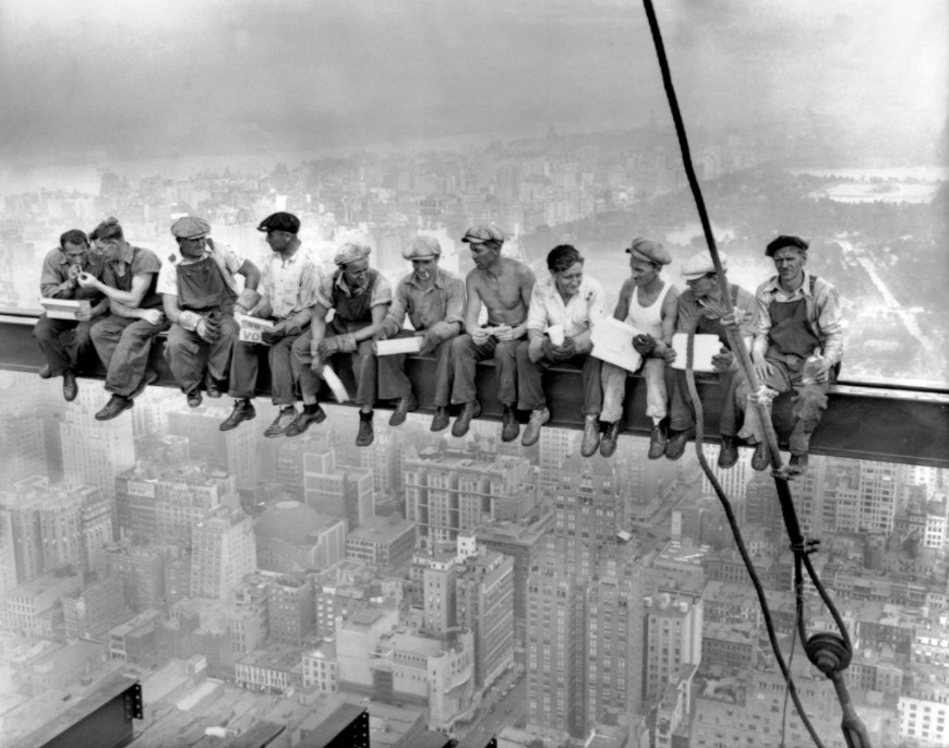 "TIL this famous photo called ""Lunch atop a Skyscraper"" wasn't the unfinished Empire State Building, it was 30 Rockefeller Center."