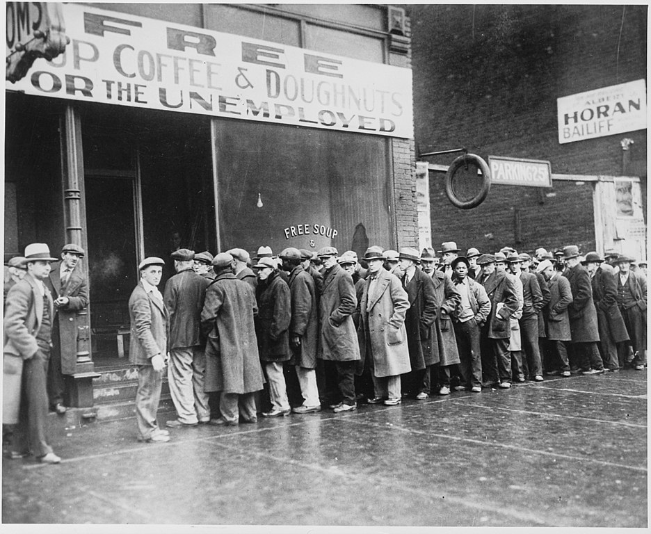 937px Unemployed men queued outside a depression soup kitchen opened in Chicago by Al Capone 02 1931 NARA 541927 image