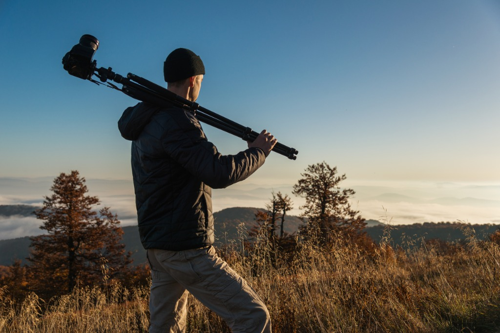photographer with camera in mountains picture id866309802 image