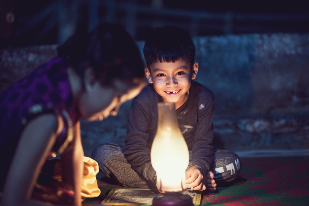 boy and girl studying in oil lamp picture id688554456 image