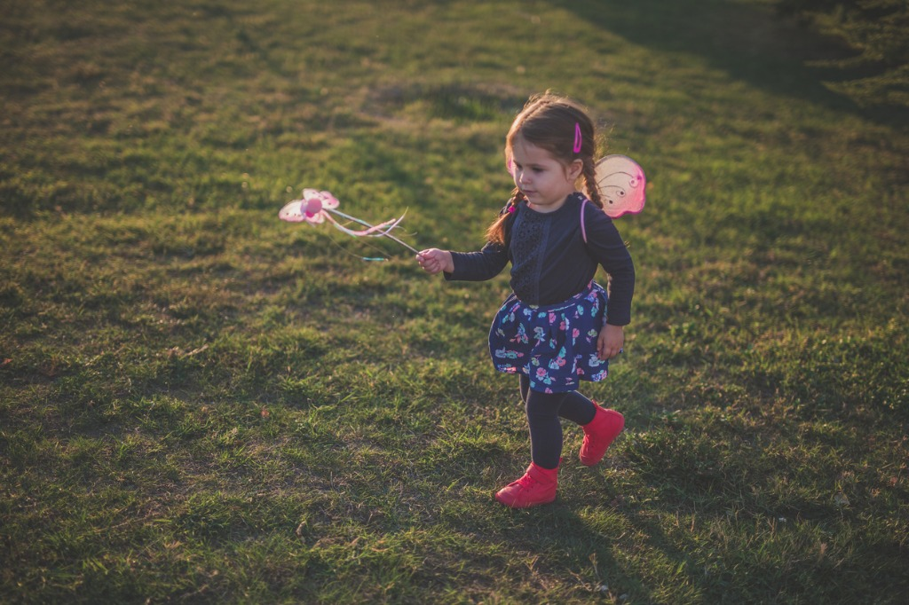 cute 2 year old fairy running and playing in nature picture id867026904 image