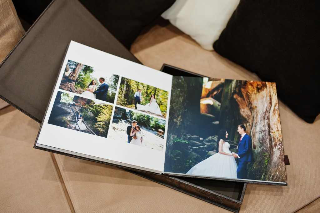 open pages of brown luxury leather wedding book or album picture id672558694 image