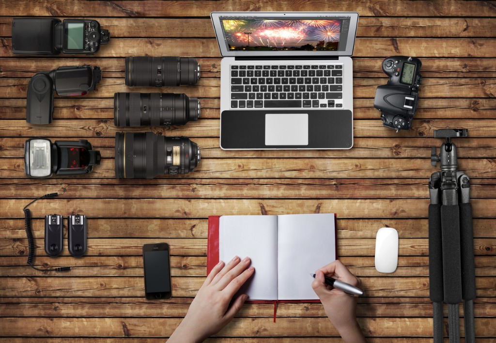 wooden surface with laptop and photography equipment picture id511437377 image