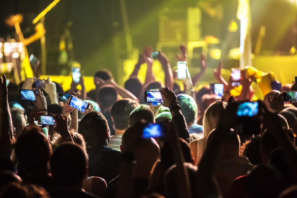 crowd at concert and blurred stage lights picture id667709450 image
