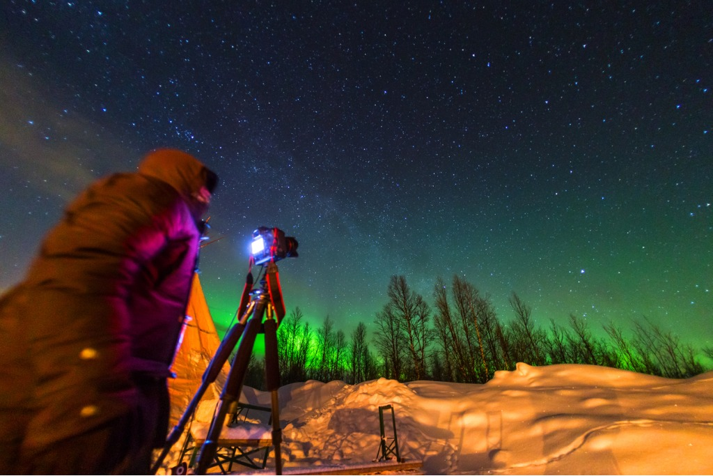 someone filming the northern lights in sweden picture id463174211