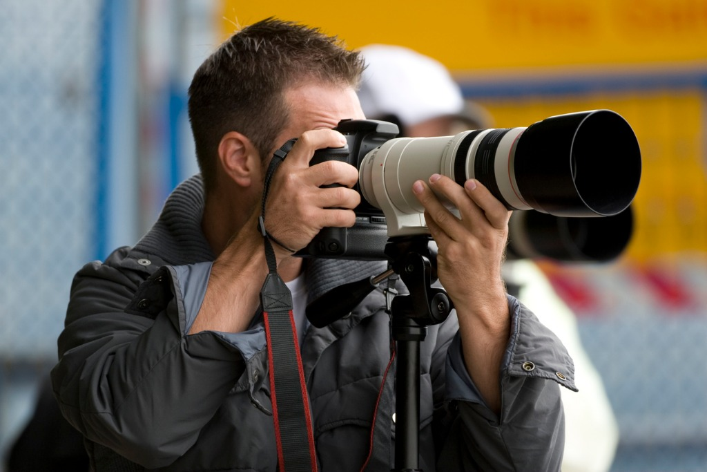 photographers with telephoto lens picture id172415502 image