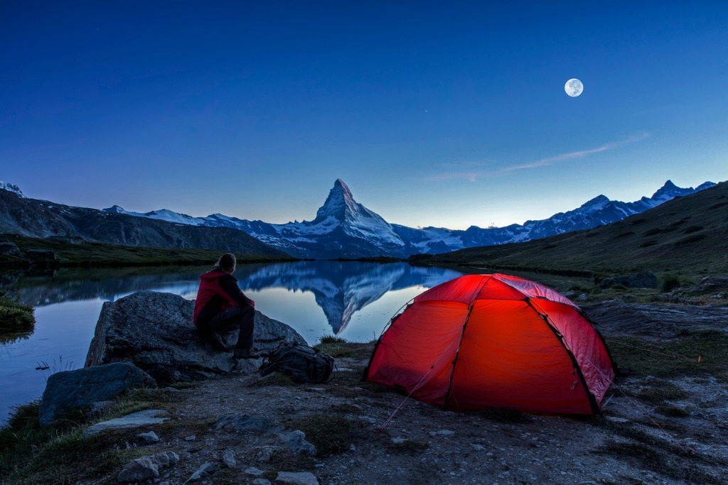 camper under full moon at matterhorn picture id587540120 image