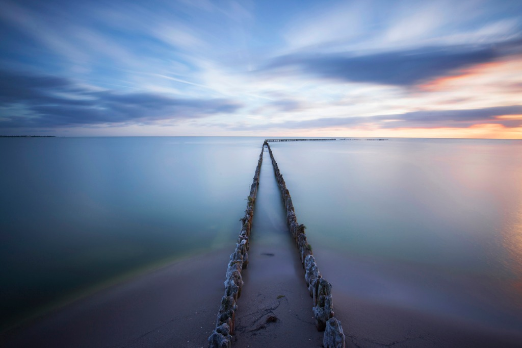 seascape with breakwaters at sunset picture id478800680 image
