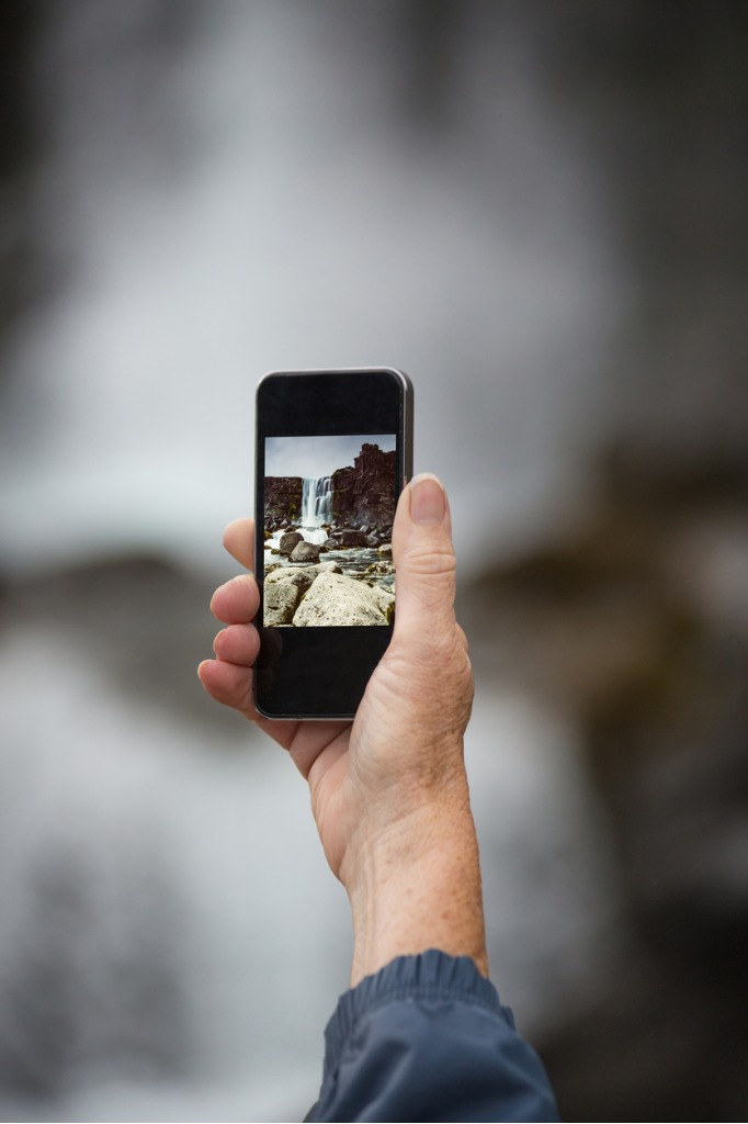 female senior traveler photographing with smartphone the waterfa picture id621834650 image