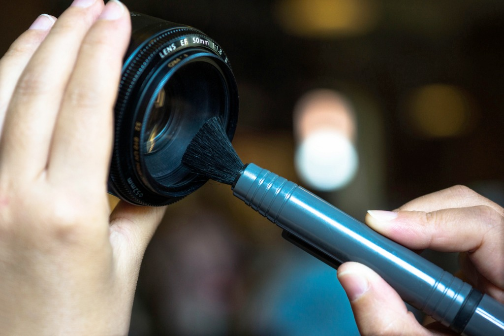 cleaning a lens with a brush picture id498175407 image