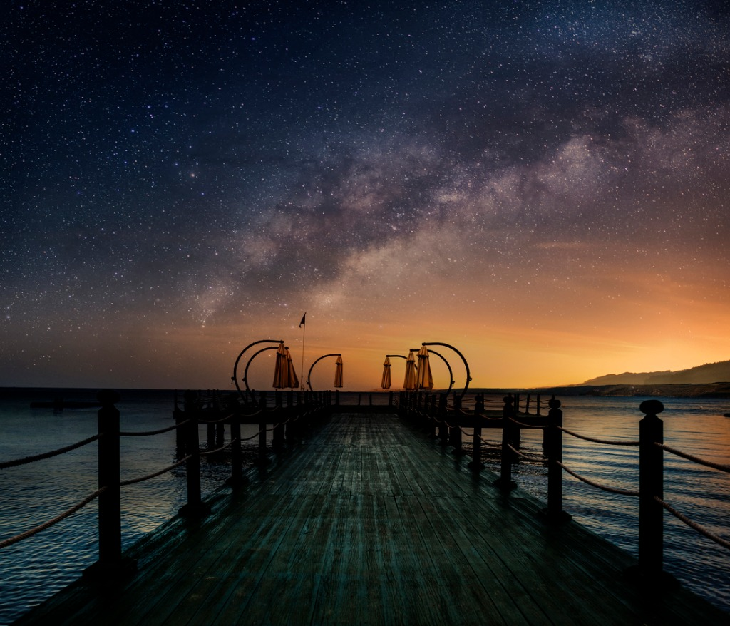 beautiful night seascape with milky way in the sky and pier into the picture id826802478