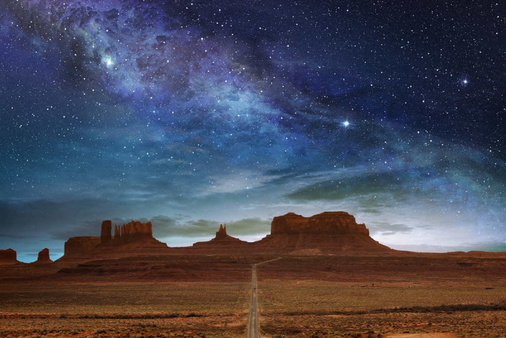 monument valley under a night starry sky picture id607283762
