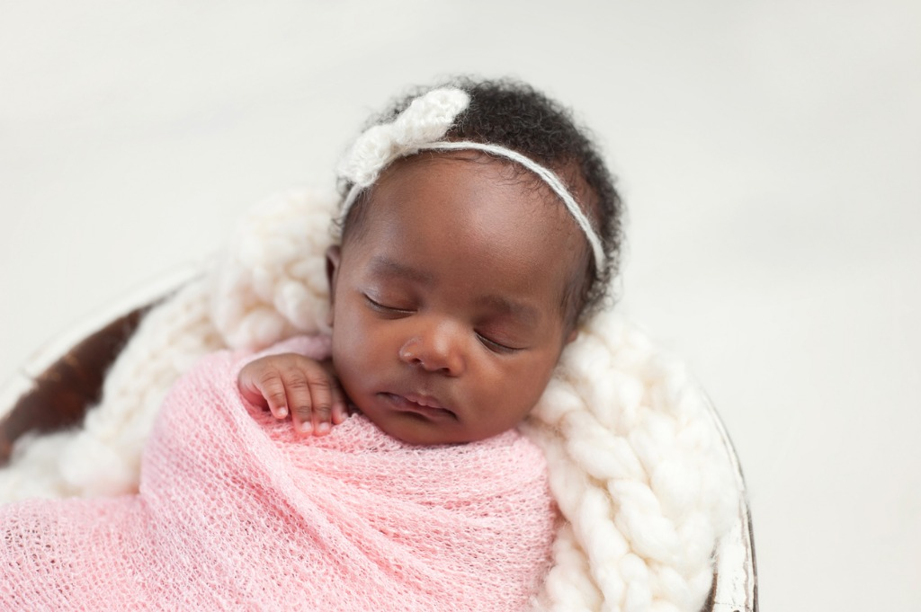newborn baby girl sleeping in bowl picture id636253690 image