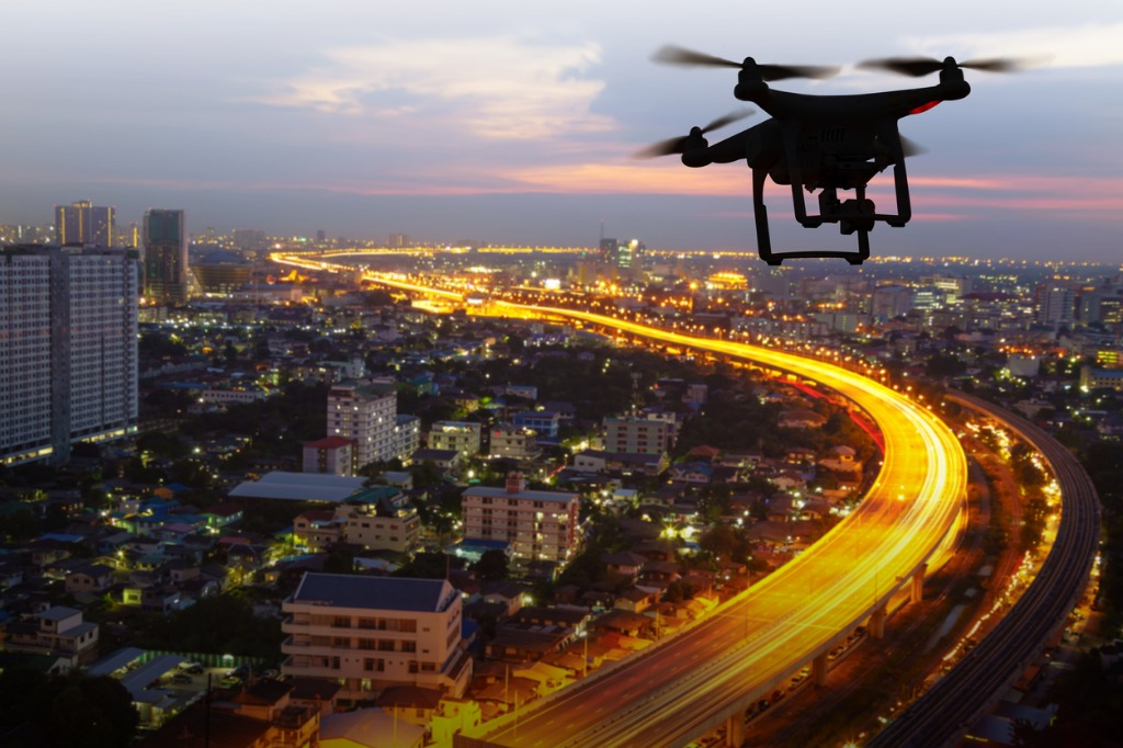silhouette of drone flying above city at sunset picture id890004548 image