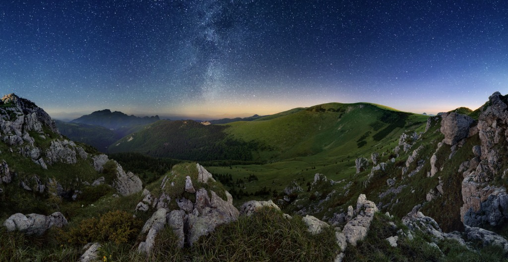 milky way over green valley mountain picture id817307054