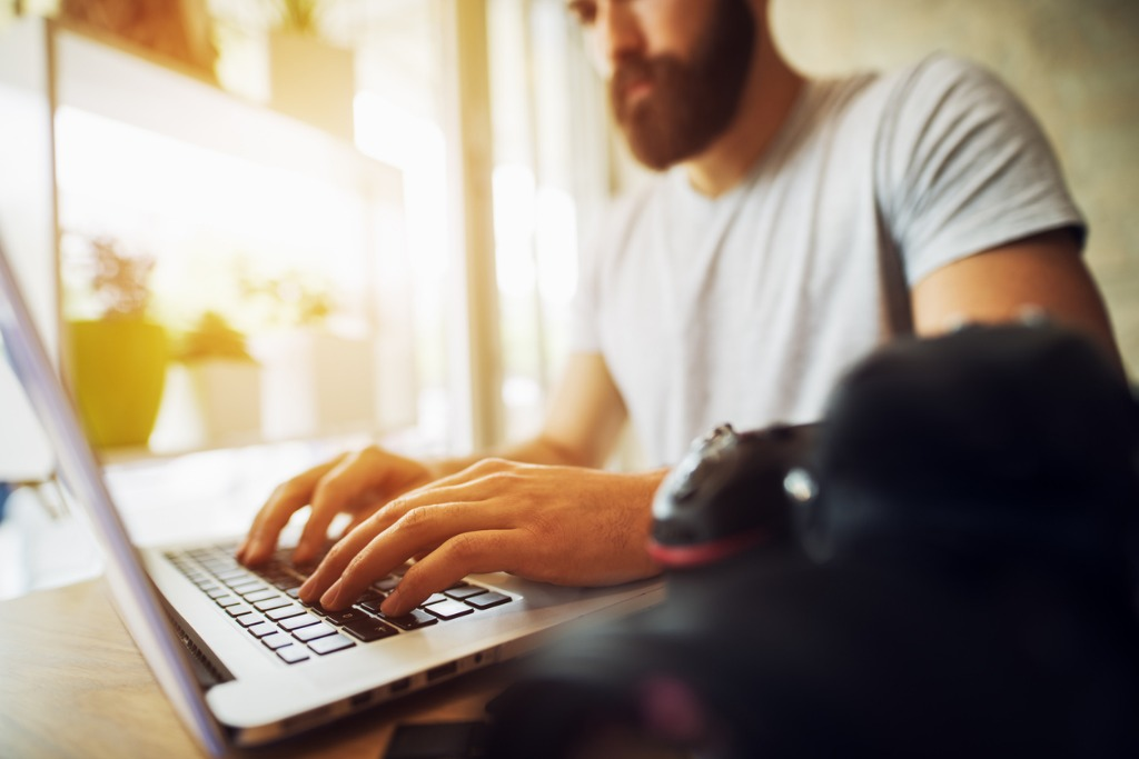 hipster photographer at his office male hands typing on a laptop picture id918328676 image