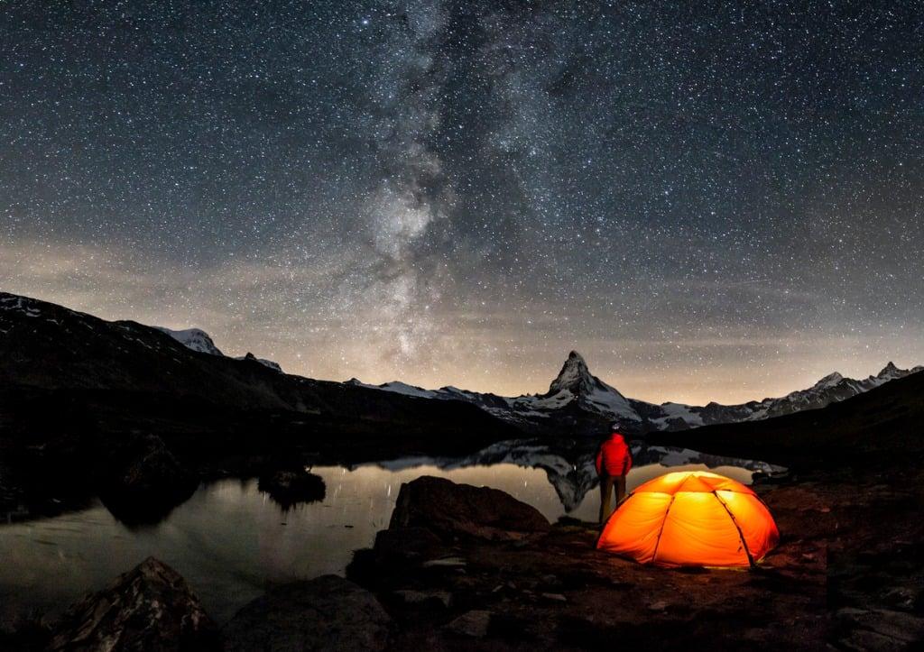 loneley camper under milky way at matterhorn picture id576583816 image