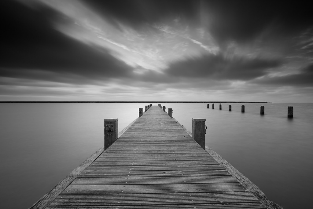 jetty at lake markermeer in black and white picture id629867138 image