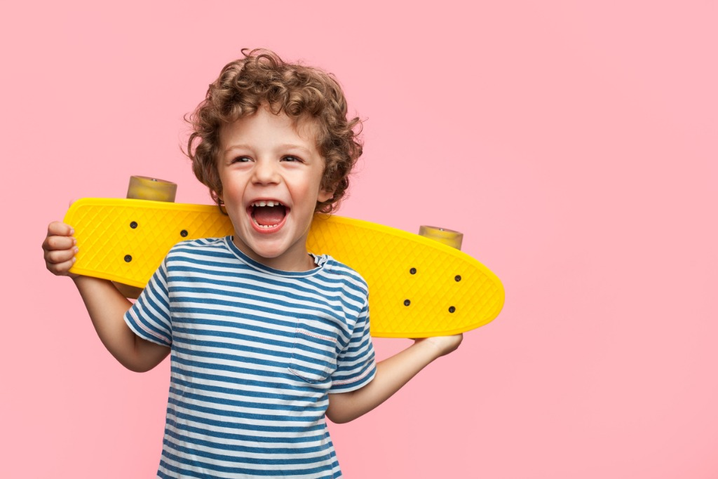 cheerful boy with yellow longboard picture id846743304 image