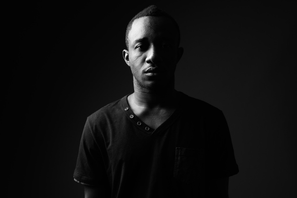 studio shot of young african man wearing black shirt in black and picture id862263568 image