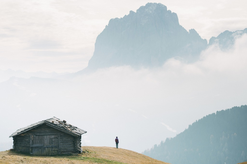 man standing near the hut with view of dolomites mountains italy picture id899107252 image