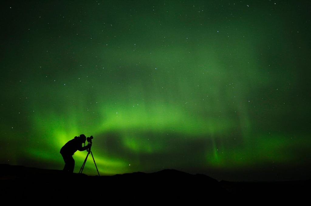 silhouette of photographer shooting aurora picture id616889002