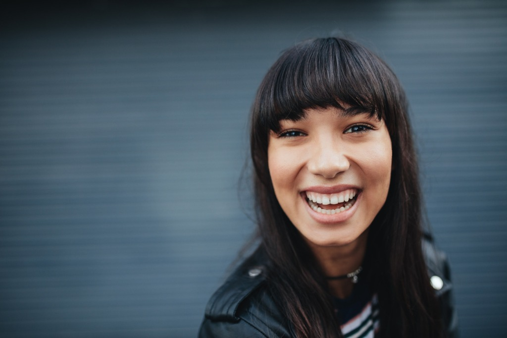young woman laughing against gray background picture id696384116 image
