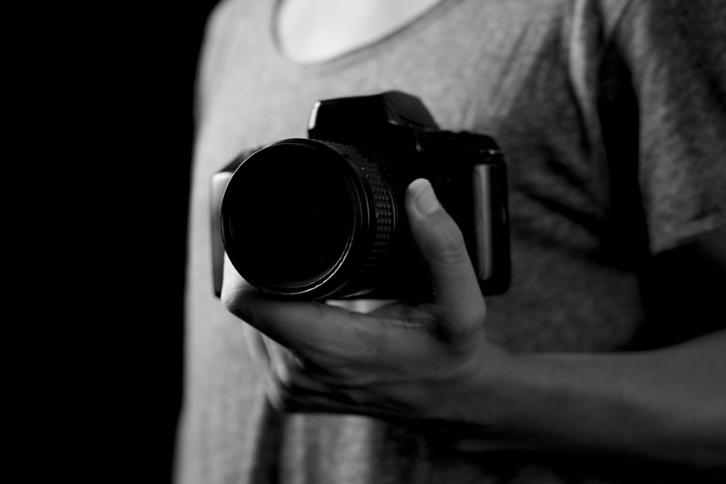 young man with a reflex camera picture id931688156 image