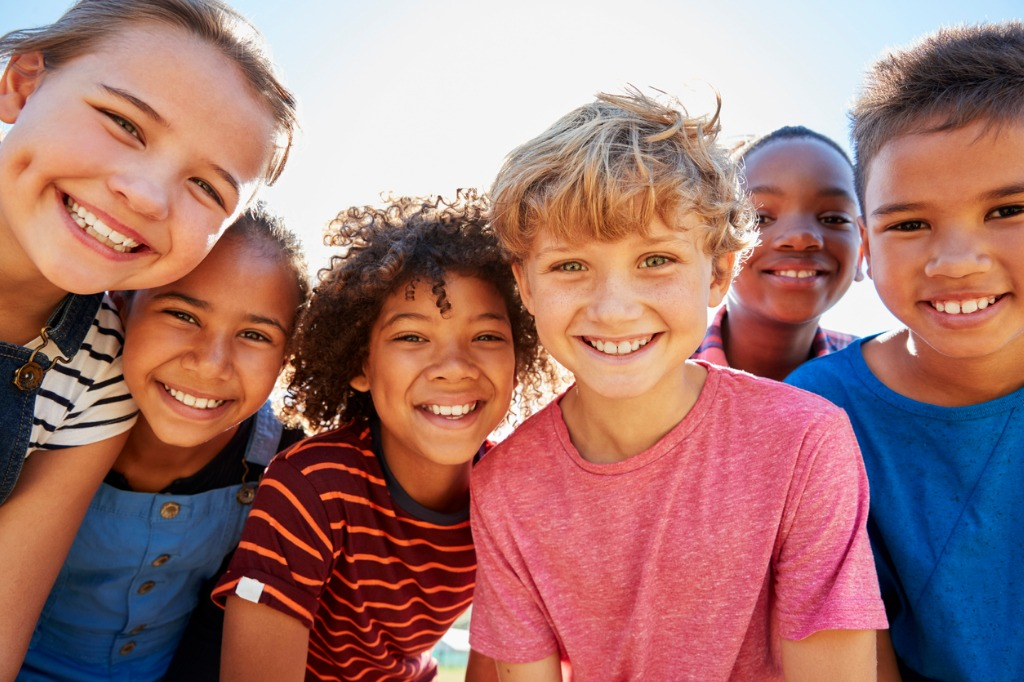 close up of preteen friends in a park smiling to camera picture id839295912 image