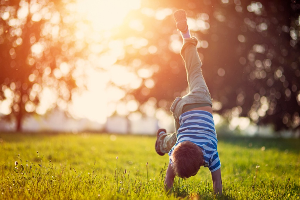little boy standing on hands on grass picture id656511746 image