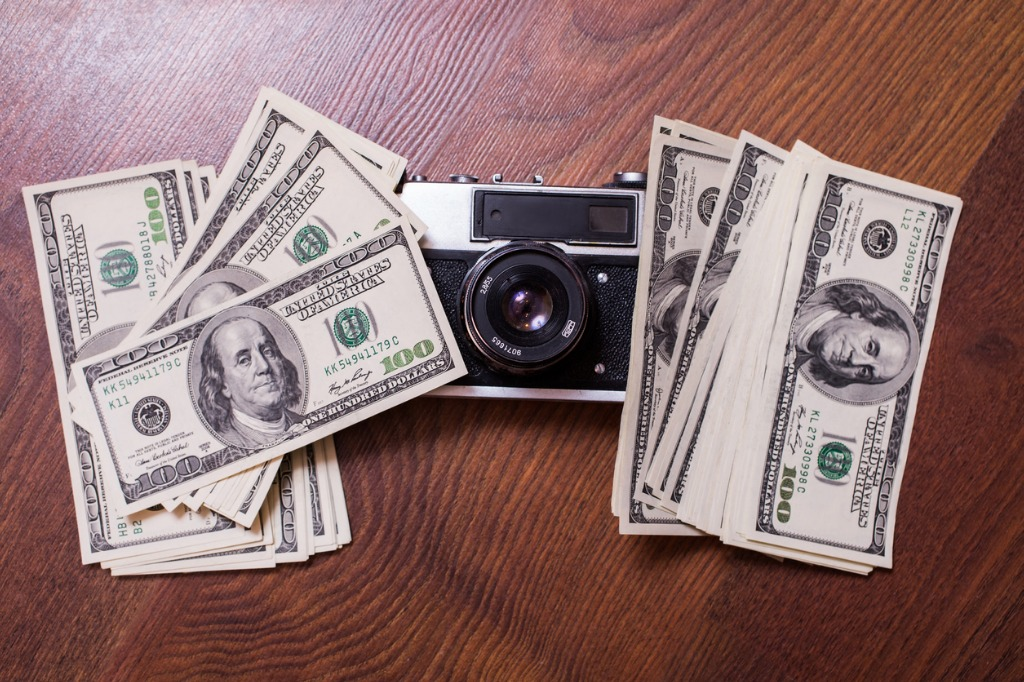 camera and moneybusiness plan money background hundred dollar bills picture id680809066 image
