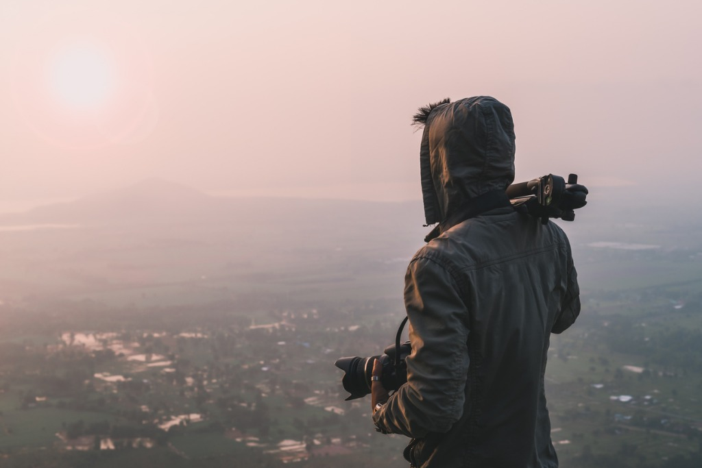 man traveler photographer and camera taking photo on mountains in the picture id928307128 image