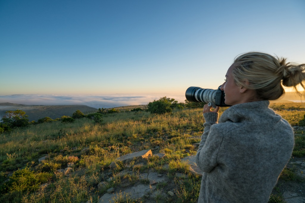 young woman on safari photographing landscape picture id670973634 image