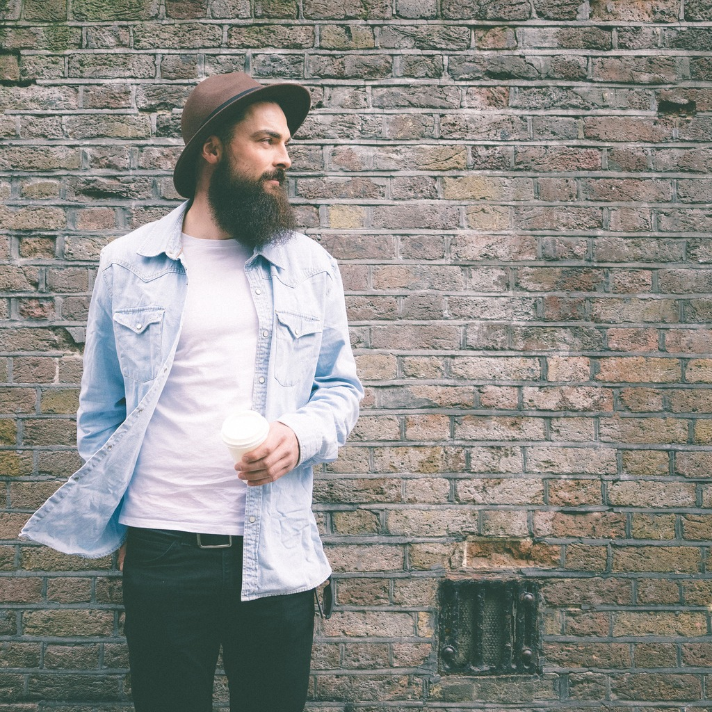 portrait of a bearded man on brick wall background picture id473236142 image