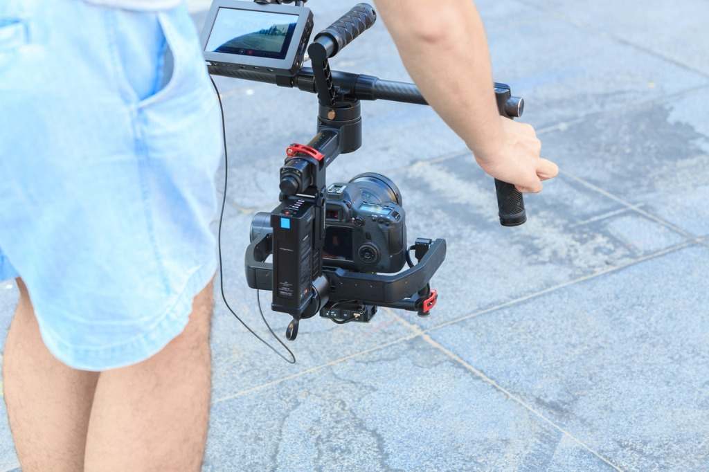 professional videographer with gimball video dslr picture id511519212 image
