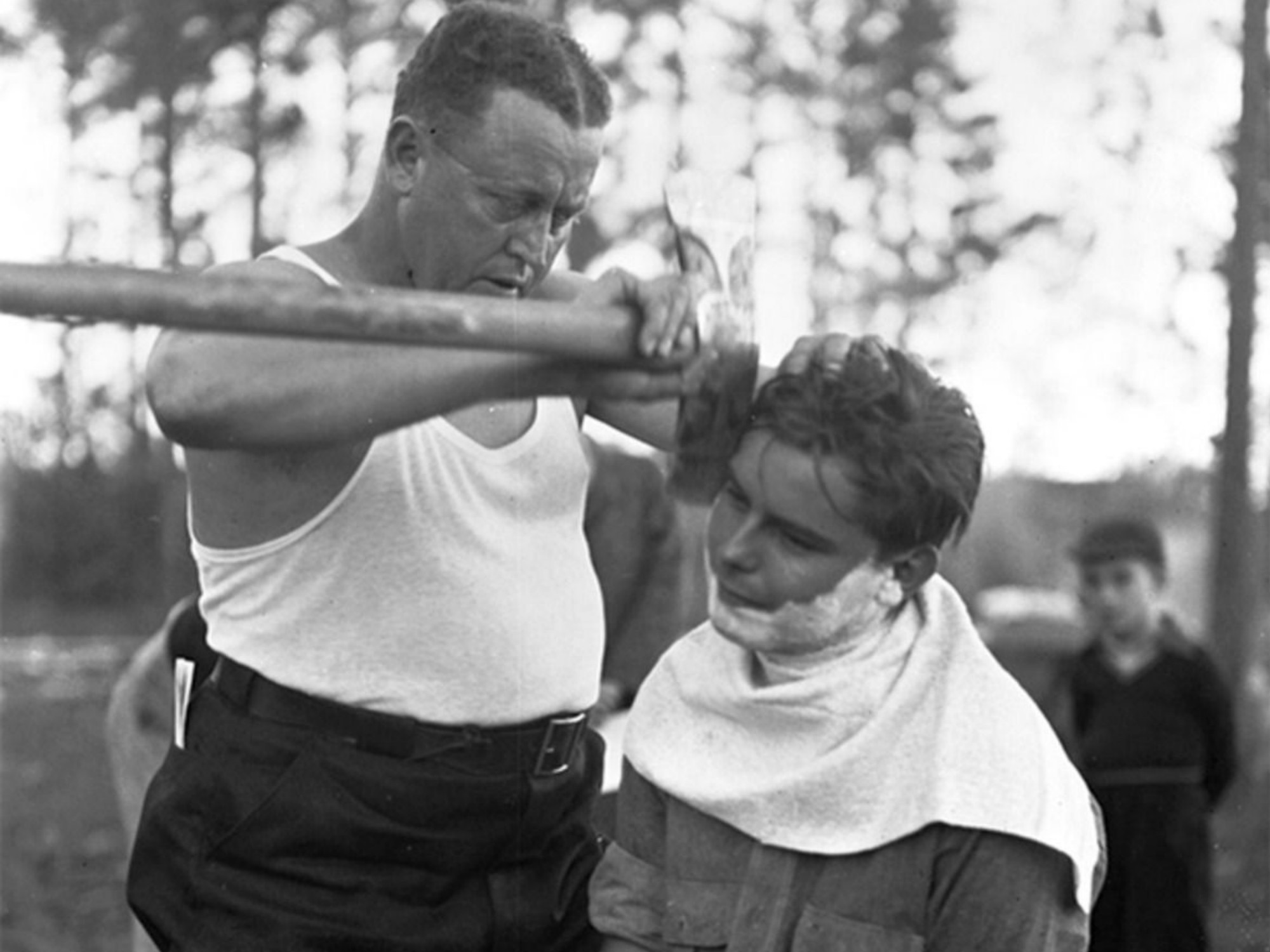 amazing historical photos shaving with an axe image