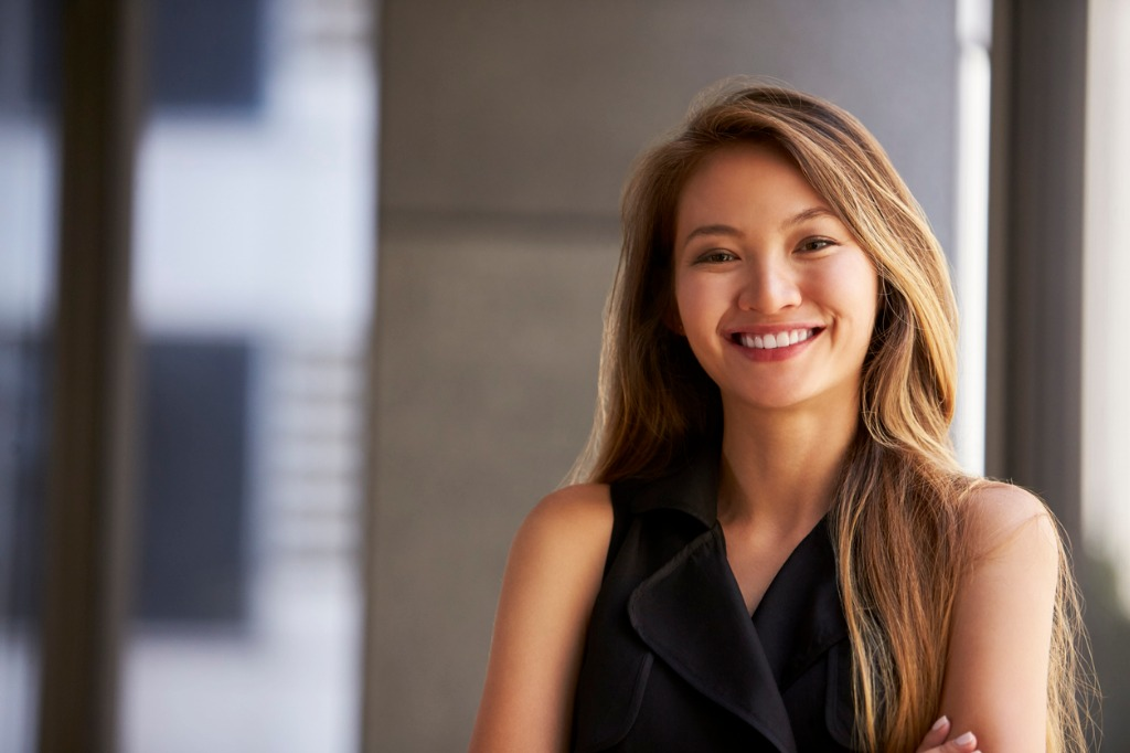 young asian businesswoman smiling to camera close up picture id639468298 image