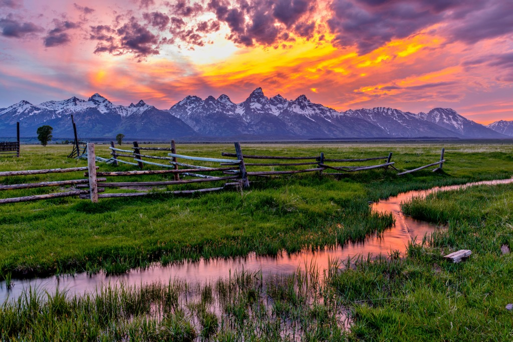 golden fiery sunset at grand teton picture id584864408 image