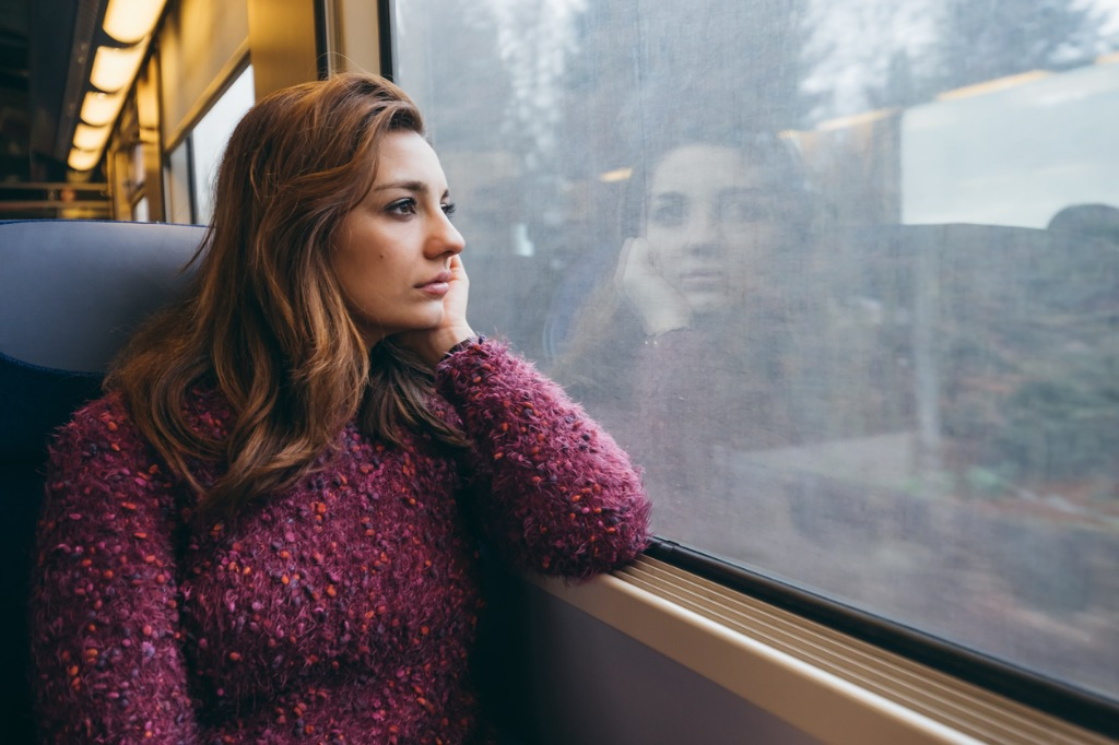 young woman traveling in train lost in thought picture id904880232 image