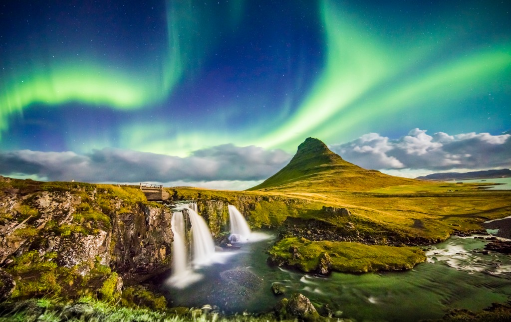 aurora over kirkjufell and waterfall at night picture id665760790 image