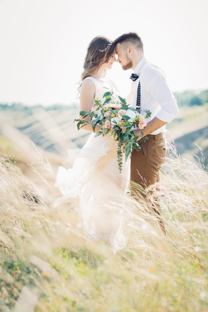 bride and groom hugging at the wedding in nature picture id639390508 image