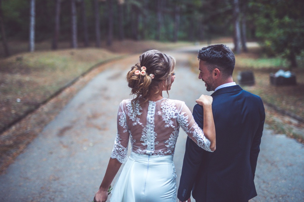 bride and groom walking together picture id868947964 image