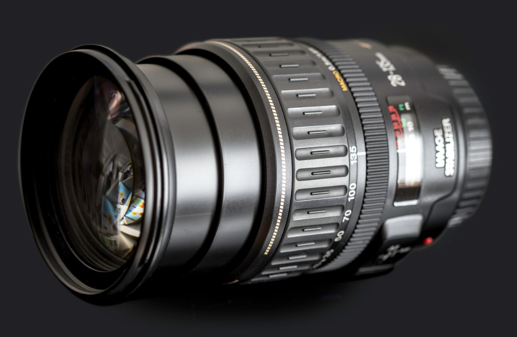 dslr zoom lens on black picture id172435389 image