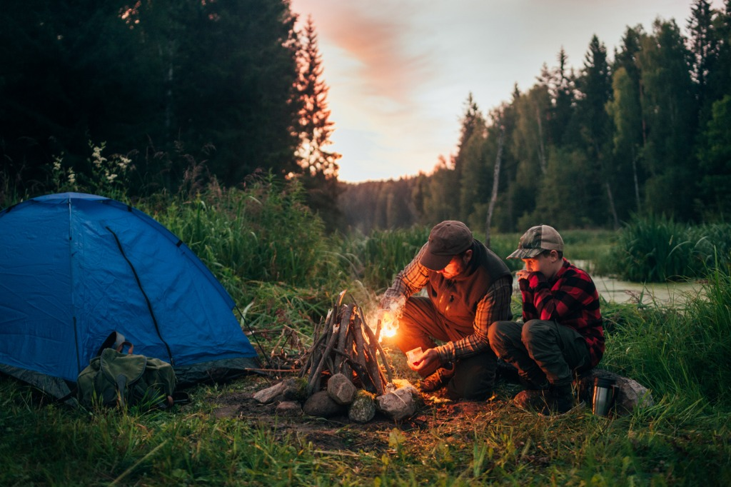 father and son camping together picture id833226490