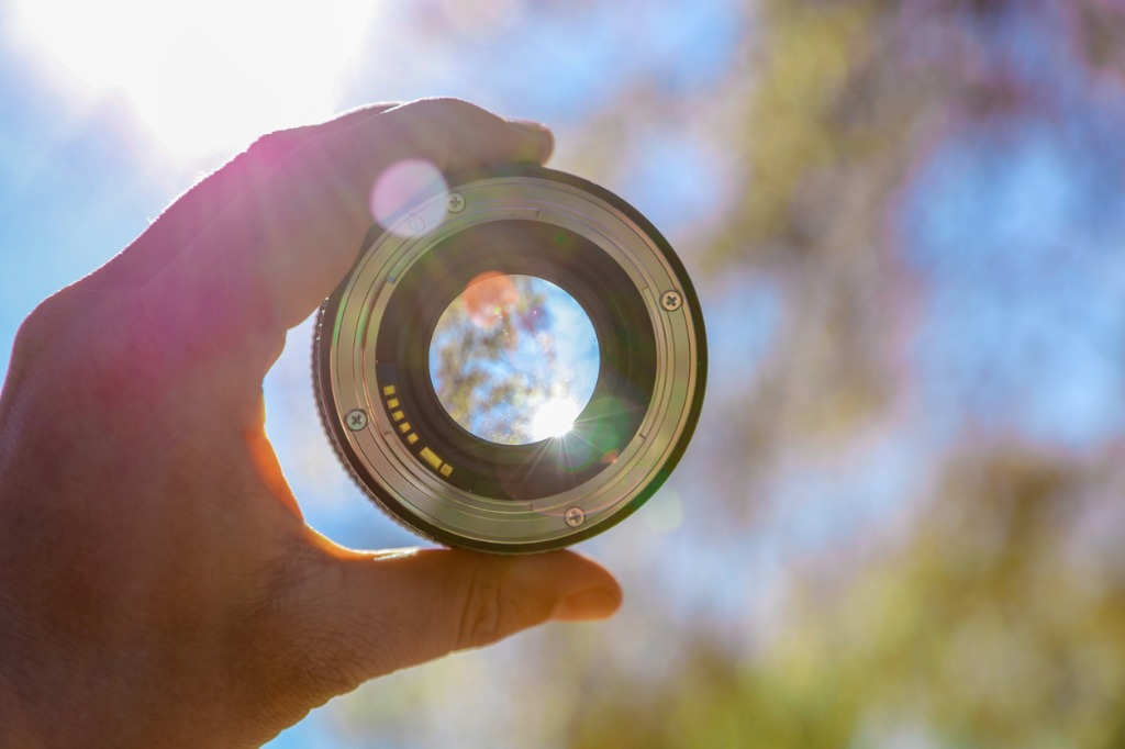 photographer holding up lens picture id518523826 image