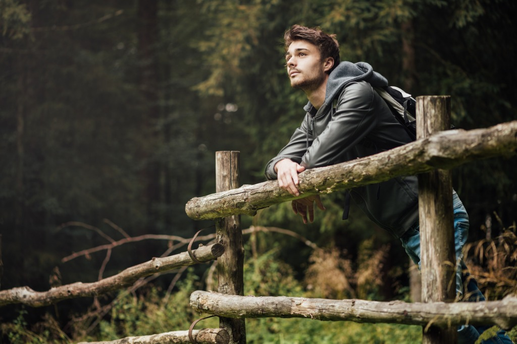 young man hiking in the forest picture id512098356 image